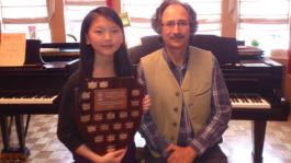 Claire Liu with BCRMTA Highest Mark Trophy for her grade 10 RCM Piano   Exam