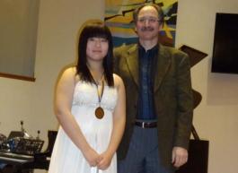 Annie Cao with BCRMTA Highest Mark Medal for her grade 10 RCM Piano Exam