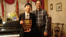 Charlie Liu with BCRMTA Highest Mark Trophy for his ARCT Diploma Piano Exam
